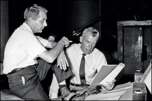 "Stanley Wilson confers with ""M Squad"" star Lee Marvin about music."